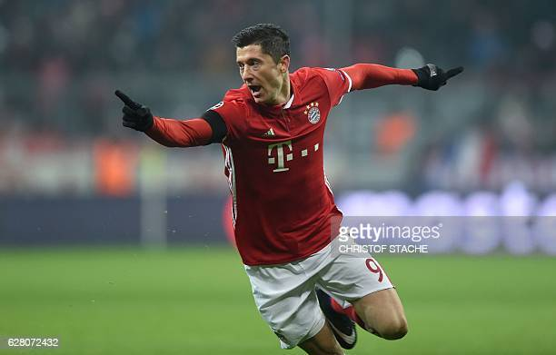 Bayern Munich's Polish striker Robert Lewandowski celebrates scoring the opening goal during the UEFA Champions League group D football match between...