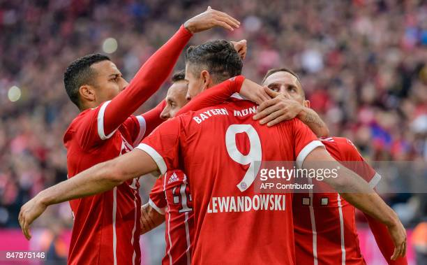 Bayern Munich's Polish striker Robert Lewandowski celebrates with team mates his second goal during the German First division Bundesliga football...