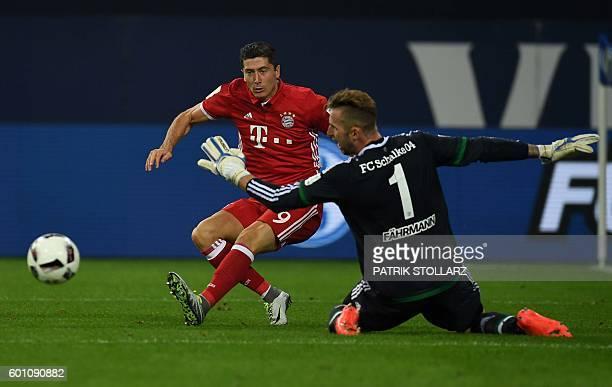 Bayern Munich's Polish striker Robert Lewandowski fails to score past Schalke's goalkeeper Ralf Faehrmann during the German first division Bundesliga...