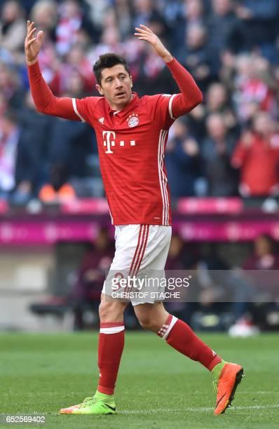 Bayern Munich's Polish striker Robert Lewandowski gestures during the German First division Bundesliga football match Bayern Munich vs Eintracht...