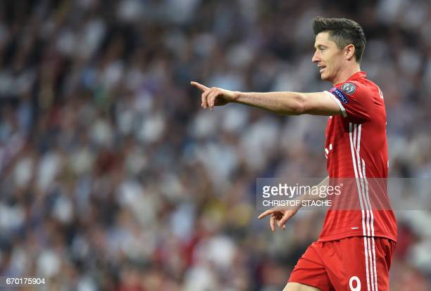 Bayern Munich's Polish striker Robert Lewandowski gestures during the UEFA Champions League quarterfinal second leg football match Real Madrid vs FC...
