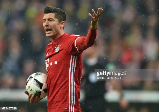 Bayern Munich's Polish striker Robert Lewandowski gestures during the German Cup DFB Pokal semifinal football match between FC Bayern Munich and BVB...