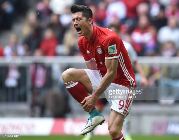 Bayern Munich's Polish striker Robert Lewandowski reacts after a foul during the German First division Bundesliga football match between FC Bayern...