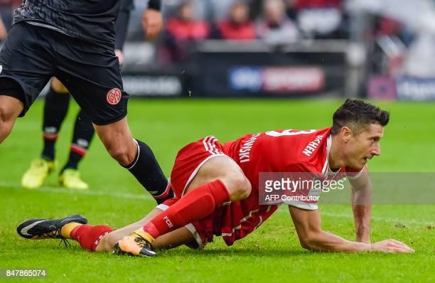 Bayern Munich's Polish striker Robert Lewandowski reacts after he scored the 30 during the German First division Bundesliga football match FC Bayern...