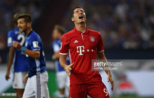 Bayern Munich's Polish striker Robert Lewandowski reacts during the German first division Bundesliga football match between Schalke 04 and FC Bayern...