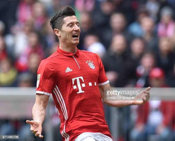 Bayern Munich's Polish striker Robert Lewandowski reacts during the German First division Bundesliga football match between FC Bayern Munich and...