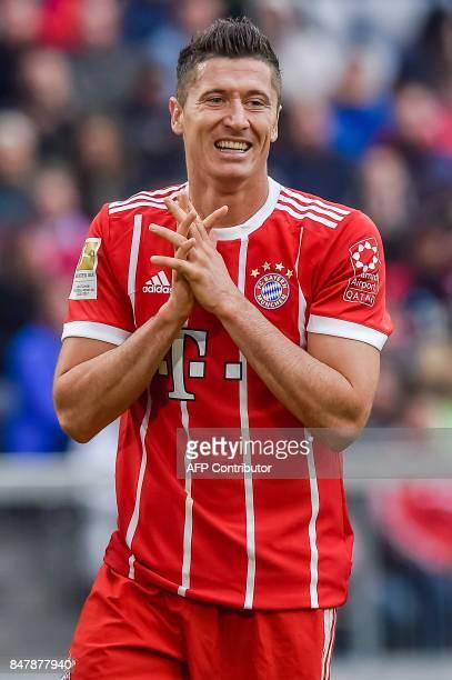 Bayern Munich's Polish striker Robert Lewandowski reacts during the German First division Bundesliga football match FC Bayern Munich v Mainz 05 in...