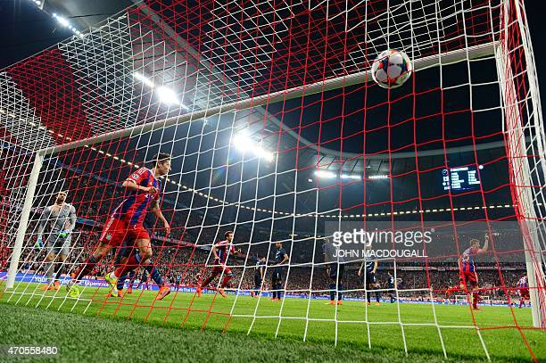 Bayern Munich's Polish striker Robert Lewandowski scores during the UEFA Champions League secondleg quarterfinal football match Bayern Munich v FC...