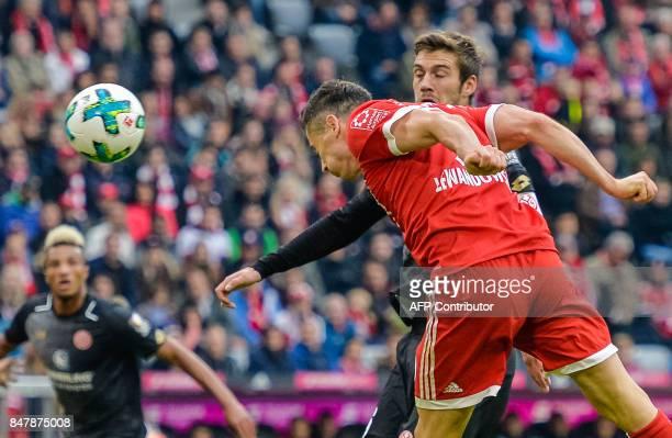Bayern Munich's Polish striker Robert Lewandowski scores his second goal during the German First division Bundesliga football match FC Bayern Munich...