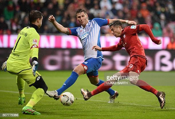 Bayern Munich's Polish striker Robert Lewandowski scores the 10 against Hoffenheim's goalkeeper Oliver Baumann during the German first division...