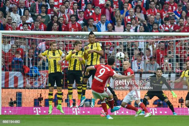 Bayern Munich's Polish striker Robert Lewandowski scores the 20 from a free kick during the German first division Bundesliga football match FC Bayern...