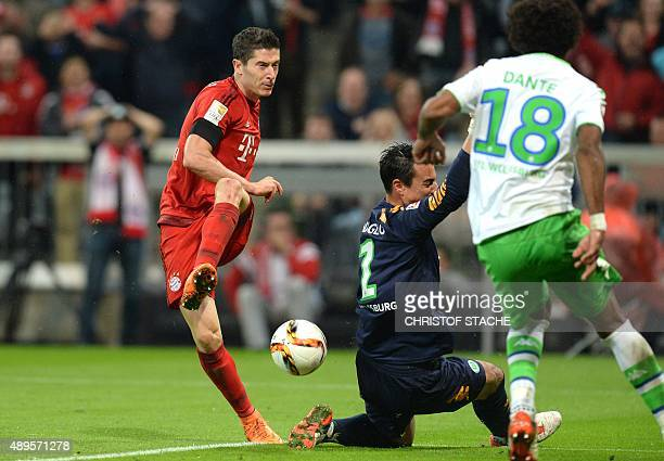Bayern Munich's Polish striker Robert Lewandowski shoots the third goal for Munich during the German first division Bundesliga football match FC...