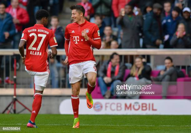 Bayern Munich's Polnish striker Robert Lewandowski and Bayern Munich's Austrian midfielder David Alaba celebrate the third goal during the German...