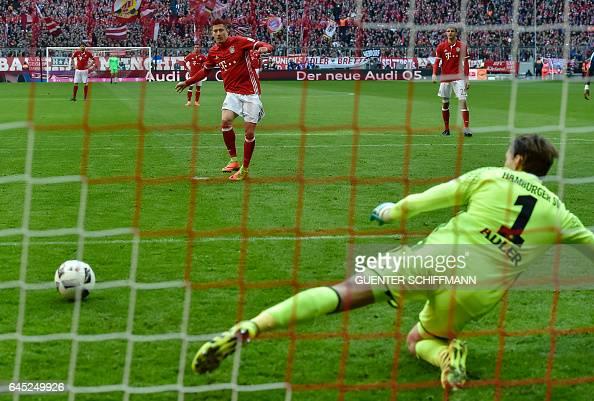 TOPSHOT Bayern Munich's Polnish striker Robert Lewandowski scores a penalty during the German first division Bundesliga football match between Bayern...