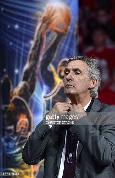 Bayern Munich's Serbian basketball headcoach Svetislav Pesic reacts during the winner ceremony after the fifth final play off basketball match Brose...
