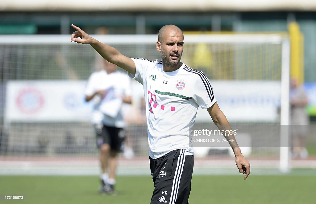 Bayern Munich's Spain head coach Pep Guardiola gestures during the training session at the team training camp of FC Bayern Munich in Arco, Italy, on July 9, 2013.