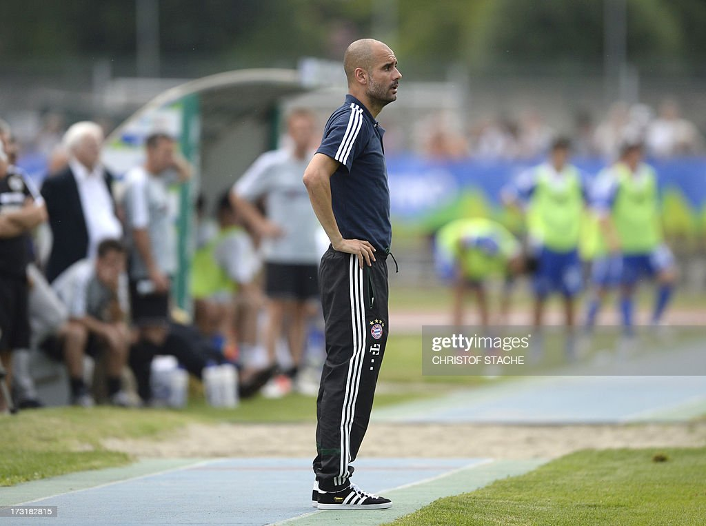 Bayern Munich's Spainish headcoach Pep Guardiola follows the test match between FC Bayern Munich and Brescia Calcio in the stadium in Arco, Itlay, on July 9, 2013. AFP PHOTO/CHRISTOF STACHE