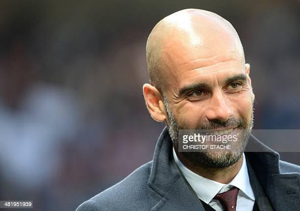 Bayern Munich's Spanish head coach Pep Guardiola arrives for the UEFA Champions League quarterfinal first leg football match between Manchester...