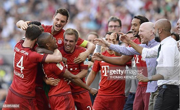 Bayern Munich's Spanish head coach Pep Guardiola celebrates with his players after his team scored the winning goal for Munich's 21 victory during...