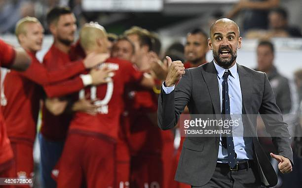 Bayern Munich's Spanish head coach Pep Guardiola reacts during the German Supercup football match VfL Wolfsburg vs Bayern Munich in Wolfsburg central...