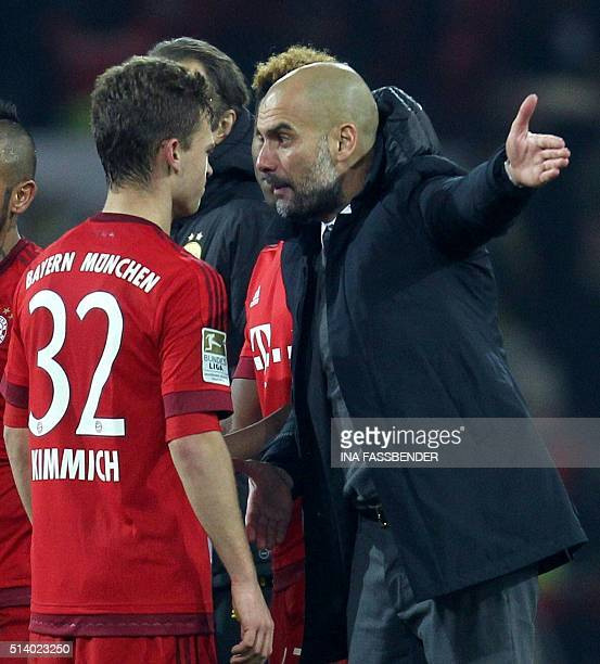 Bayern Munich's Spanish head coach Pep Guardiola reacts to midfielder Joshua Kimmich during the German first division Bundesliga football match of...
