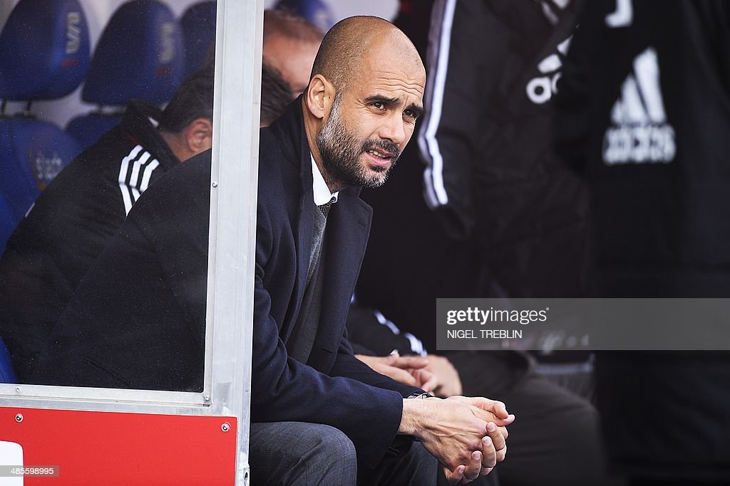 Bayern Munich's Spanish head coach Pep Guardiola sits on the bench prior to the German first division Bundesliga football match Eintracht Braunschweig vs FC Bayern Munich in Braunschweig, central Germany, on April 19, 2014.
