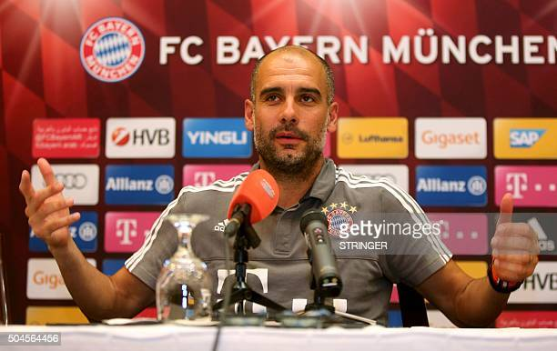 Bayern Munich's Spanish head coach Pep Guardiola speaks during a press conference at Aspire Academ in the Qatari capital Doha on January 11 2016 /...