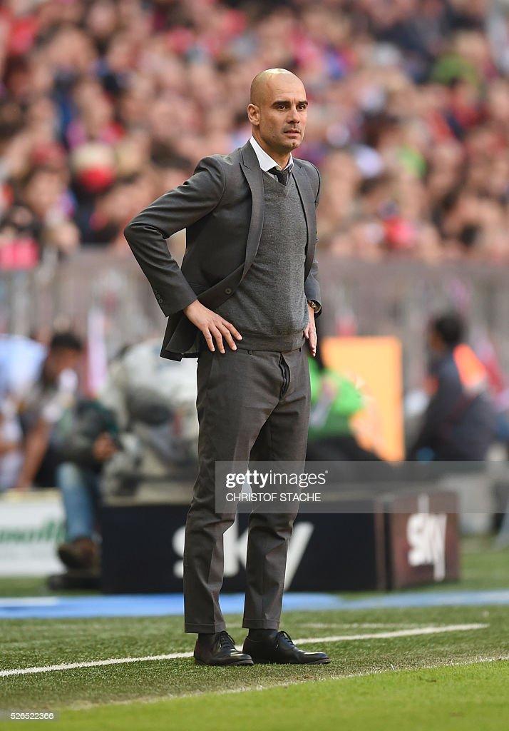 Bayern Munich's Spanish headcoach Pep Guardiola follows the German first division Bundesliga football match Bayern Munich vs Borussia Moenchengladbach in Munich, southern Germany, on April 30, 2016. / AFP / CHRISTOF