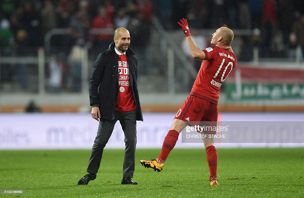 Bayern Munich's Spanish headcoach Pep Guardiola (L) jokes with Bayern Munich's Dutch midfielder Arjen Robben after the German first division Bundesliga football match of FC Augsburg vs FC Bayern Munich in Augsburg, southern Germany, on February 14, 2016. / AFP / CHRISTOF STACHE /