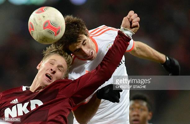 Bayern Munich's Spanish midfielder Javi Martinez and Nuremberg's striker Sebastian Polter challenge for the ball during the German first division...