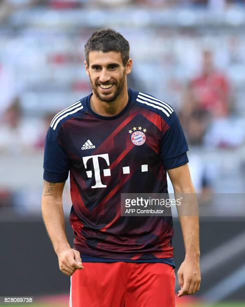 Bayern Munich's Spanish midfielder Javi Martinez laughs prior prior the third place Audi Cup football match between SSC Napoli and Bayern Munich in...