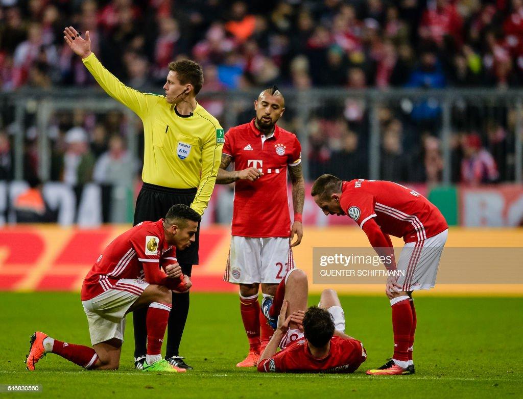 Bayern Munich s Spanish midfielder Javi Martinez lays injured on