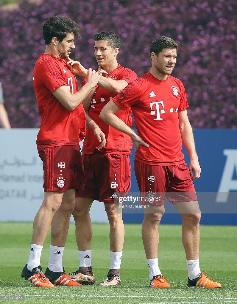Bayern Munich s Spanish midfielder Javi Martinez L Polish