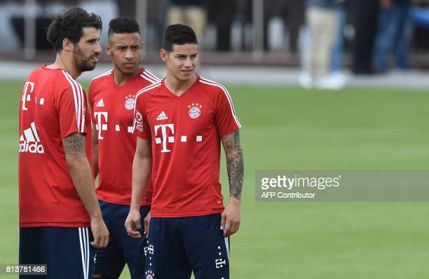 Bayern Munich's Spanish midfielder Javier Martinez Bayern Munich's new French midfielder Corentin Tolisso and Bayern Munich's new Colombian...
