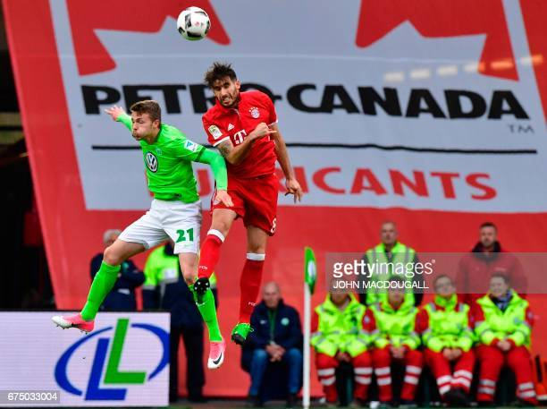 Bayern Munich's Spanish midfielder Javier Martinez vies with Wolfsburg's defender Jannes Horn during the German first division Bundesliga football...
