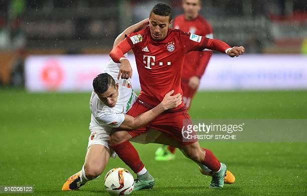 Bayern Munich's Spanish midfielder Thiago Alcantara and Augsburg's Argentinian striker Raul Bobadilla vie for the ball during the German first...