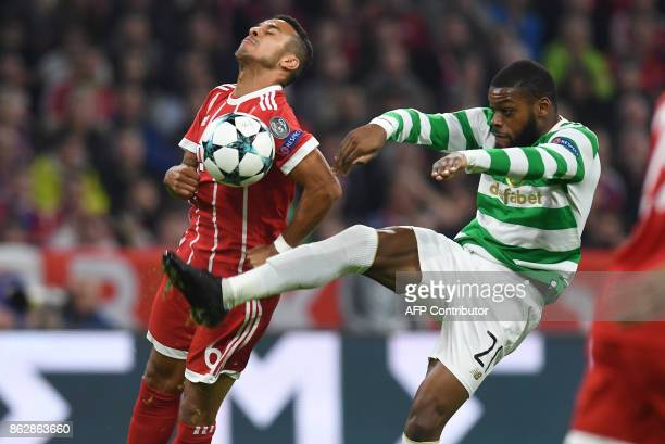 Bayern Munich's Spanish midfielder Thiago Alcantara and Celtic's French midfielder Olivier Ntcham vie for the ball during the Champions League group...
