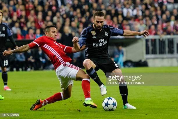 Bayern Munich's Spanish midfielder Thiago Alcantara and Madrid's Spanish defender Dani Carvajal vie for the ball during the UEFA Champions League 1st...