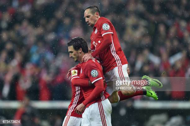 Bayern Munich's Spanish midfielder Thiago Alcantara Bayern Munichs defender Mats Hummels and Bayern Munich's French midfielder Franck Ribery...