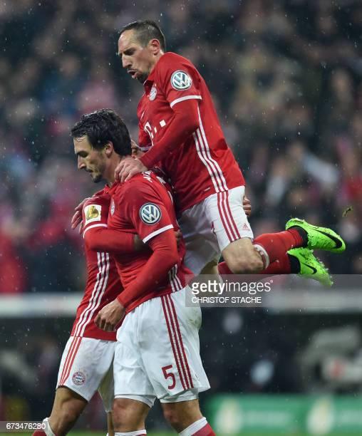Bayern Munich's Spanish midfielder Thiago Alcantara Bayern Munich's defender Mats Hummels and Bayern Munich's French midfielder Franck Ribery...