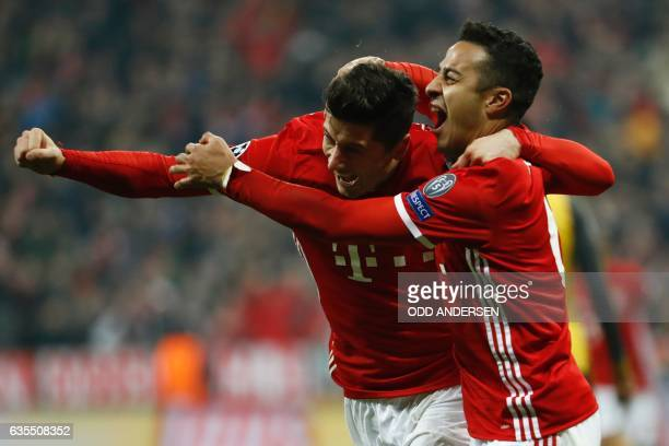 TOPSHOT Bayern Munich's Spanish midfielder Thiago Alcantara celebrate scoring the 31 goal with Bayern Munich's Polish forward Robert Lewandowski...