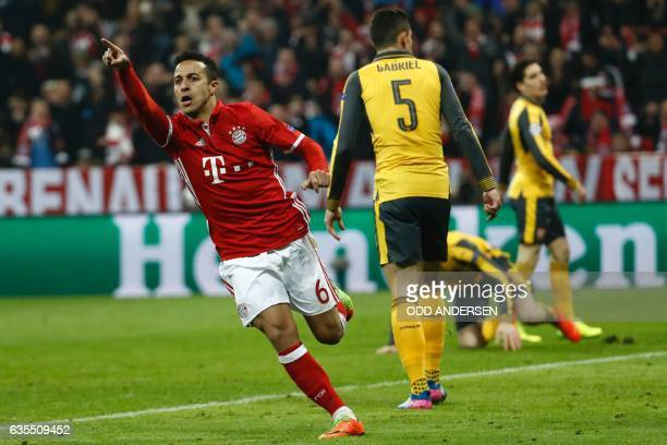 Bayern Munich's Spanish midfielder Thiago Alcantara celebrate scoring the 41 goal with Bayern Munich's Polish forward Robert Lewandowski during the...