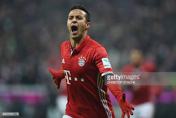 Bayern Munich's Spanish midfielder Thiago Alcantara celebrates after his first goal during the German first division Bundesliga football match FC...