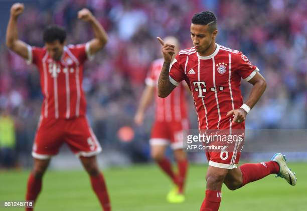 Bayern Munich's Spanish midfielder Thiago Alcantara celebrates after the third goal for Munich during the German First division Bundesliga football...