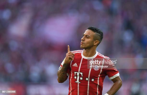 Bayern Munich's Spanish midfielder Thiago Alcantara celebrates after scoring the 30 during the German First division Bundesliga football match FC...