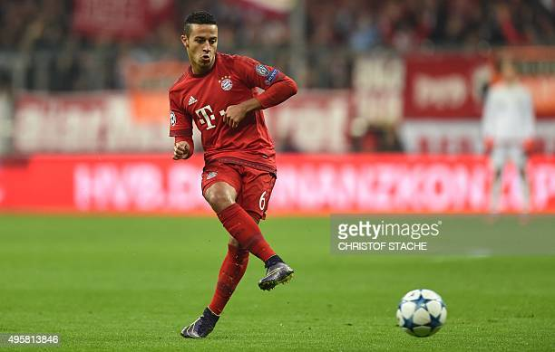 Bayern Munich's Spanish midfielder Thiago Alcantara plays the ball during the UEFA Champions League Group F secondleg football match between FC...