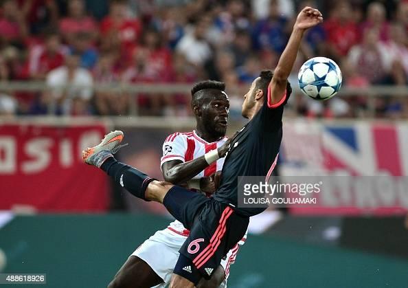 Bayern Munich's Spanish midfielder Thiago Alcantara vies for the ball against Olympiacos' French defender Arthur Masuaku during their Group F...