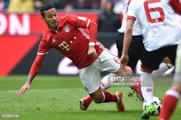 Bayern Munich's Spanish midfielder Thiago Alcantara vies for the ball during the German first division Bundesliga football match between FC Bayern...