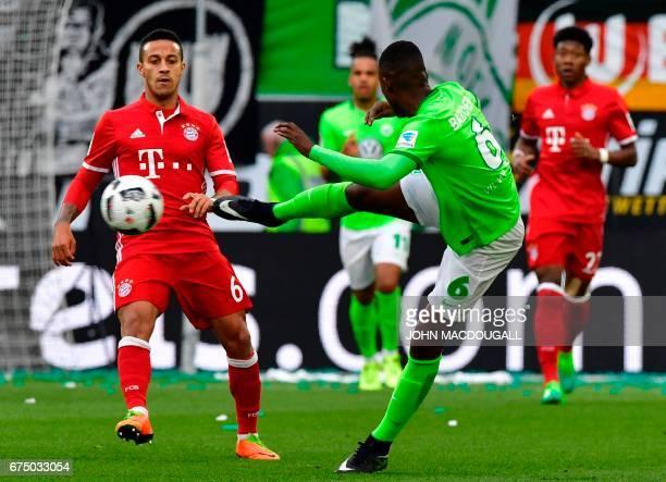 Bayern Munich's Spanish midfielder Thiago Alcantara vies with Wolfsburg's Dutch midfielder Riechedly Bazoer during the German first division...