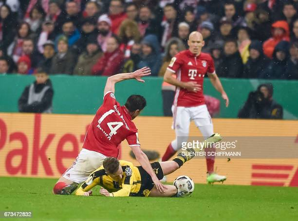 Bayern Munich's Spanish midfielder Xabi Alonso and Dortmund's German striker Marco Reus vie for the ball during the German Cup DFB Pokal semifinal...